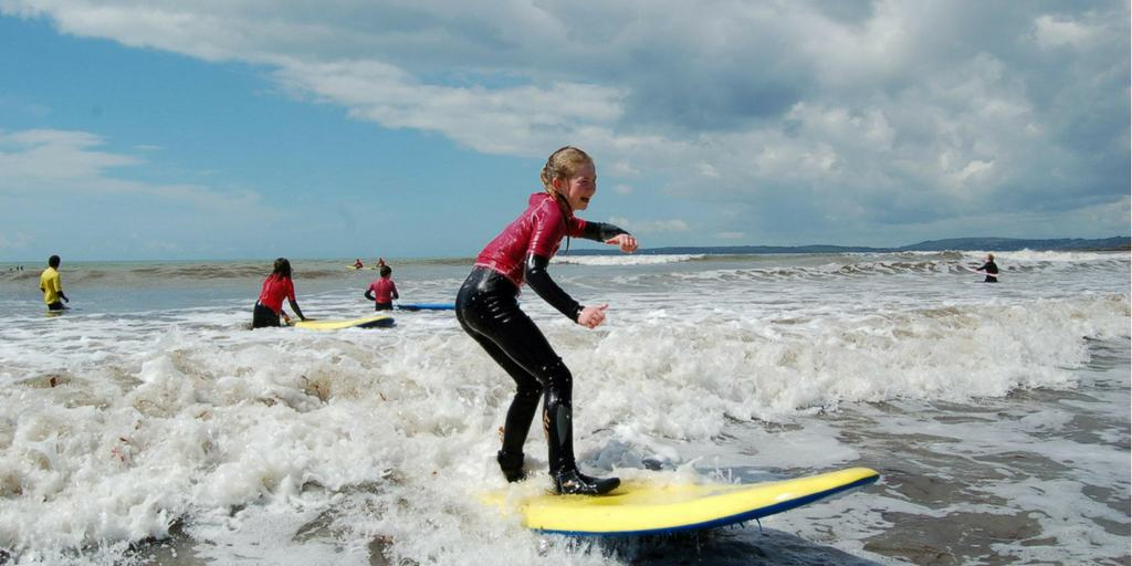 sunset surfing with Swell Surf School for Cork Harbour Festival